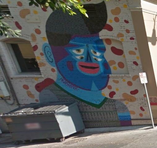 Cool street art at address for tat shop